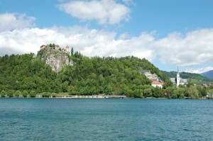 Bled castle high on the mountain with a pretty little lake