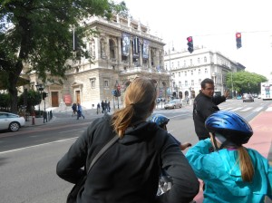 Tomas, our bike tour guide, explains that we are going to turn left at the Opera House.