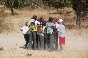 The kids hand out cookies to some Namibian school kids