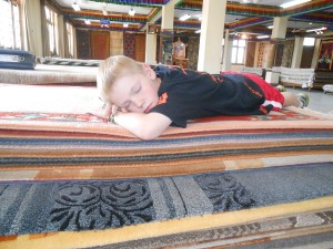 Catching some zzzz's at a rug shop in Nepal
