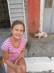 """Charlie with """"Little Peaches"""", one of her favorite street cats in Istanbul"""