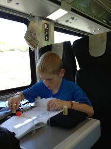 A.J. inventing a game with balls and corks, while on a train in Europe